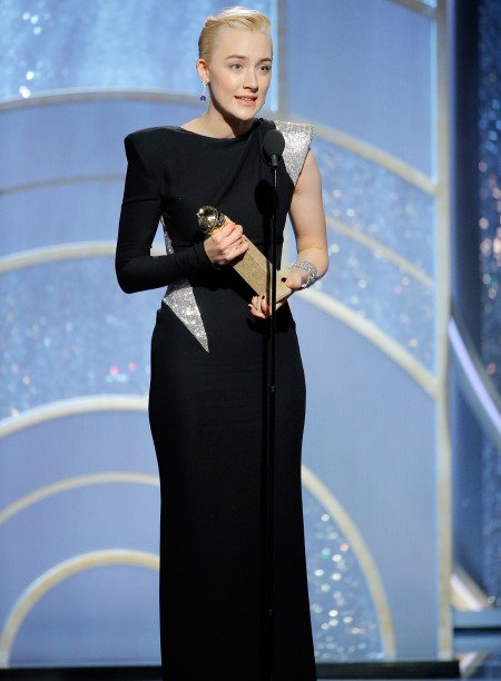 "BEVERLY HILLS, CA - JANUARY 07: In this handout photo provided by NBCUniversal, Saoirse Ronan accepts the award for Best Performance by an Actress in a Motion Picture – Musical or Comedy for ""Lady Bird"" during the 75th Annual Golden Globe Awards at The Beverly Hilton Hotel on January 7, 2018 in Beverly Hills, California. (Photo by Paul Drinkwater/NBCUniversal via Getty Images)"