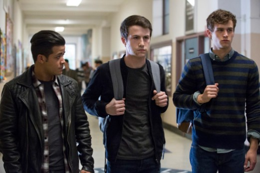 "This image released by Netflix shows, from left, Christian Navarro, Dylan Minnette and Brandon Flynn in ""13 Reasons Why."" Netflix has canceled the premiere of its second season of the teen drama ""13 Reasons Why"" because of Friday's school shooting near Houston. The first season of ""13 Reasons Why"" drew criticism for its graphic depiction of a teenager's suicide. The second season will focus on the aftermath of the girl's death, and reportedly includes a storyline about thwarted school shooting. (Beth Dubber/Netflix via AP)"