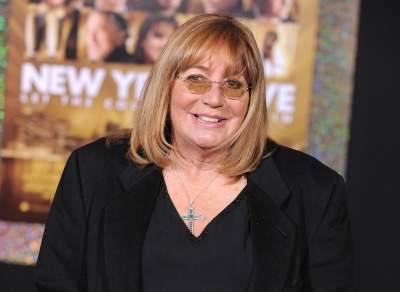 """HOLLYWOOD, CA - DECEMBER 05: Actress Penny Marshall arrives at the he Los Angeles premiere of """"New Year's Eve"""" at Grauman's Chinese Theatre on December 5, 2011 in Hollywood, California. (Photo by Jordan Strauss/Invision/AP Images)"""