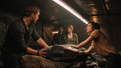 "(L to R) Owen (CHRIS PRATT), Franklin (JUSTICE SMITH), Claire (BRYCE DALLAS HOWARD) and Zia (DANIELLA PINEDA) try and save Blue in ""Jurassic World: Fallen Kingdom."" When the island's dormant volcano begins roaring to life, Owen and Claire mount a campaign to rescue the remaining dinosaurs from this extinction-level event. Welcome to ""Jurassic World: Fallen Kingdom."""