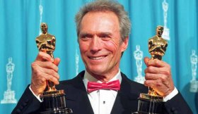"Mandatory Credit: Photo by AP/REX/Shutterstock (6569294a) Eastwood Clint Eastwood holds up his two Oscars at the Academy Awards in Los Angeles, Ca., Monday night, . Eastwood won best director for the movie ""Unforgiven, which also won best picture OSCARS EASTWOOD, LOS ANGELES, USA"