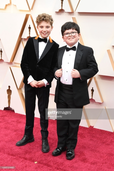 HOLLYWOOD, CALIFORNIA - FEBRUARY 09: (L-R) Roman Davis Griffin and Archie Yates attend the 92nd Annual Academy Awards at Hollywood and Highland on February 09, 2020 in Hollywood, California. (Photo by Steve Granitz/WireImage)