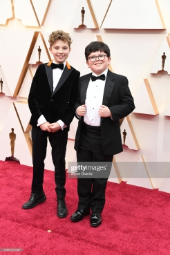 HOLLYWOOD, CALIFORNIA - FEBRUARY 09: (L-R) Roman Griffin Davis and Archie Yates attend the 92nd Annual Academy Awards at Hollywood and Highland on February 09, 2020 in Hollywood, California. (Photo by Steve Granitz/WireImage)
