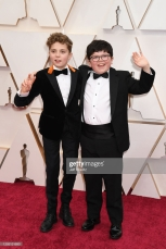 HOLLYWOOD, CALIFORNIA - FEBRUARY 09: (L-R) Roman Griffin Davis and Archie Yates attend the 92nd Annual Academy Awards at Hollywood and Highland on February 09, 2020 in Hollywood, California. (Photo by Jeff Kravitz/FilmMagic)