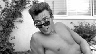 LOS ANGELES - JUNE 1: Actor Clint Eastwood lies on a towel and looks over his sunglasses at home on June 1, 1956 in Los Angeles, California. (Photo by Earl Leaf/Michael Ochs Archives/Getty Images)