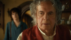 "(L-r) ELIJAH WOOD as Frodo and IAN HOLM as Bilbo Baggins in the fantasy adventure ""THE HOBBIT: AN UNEXPECTED JOURNEY,"" a production of New Line Cinema and Metro-Goldwyn-Mayer Pictures (MGM), released by Warner Bros. Pictures and MGM."